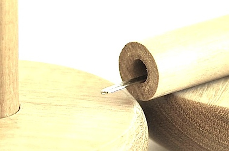Darning mushroom with needle store in handle
