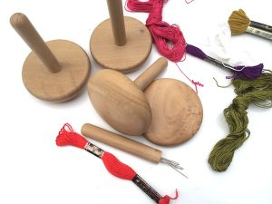 darning mushroom with needles