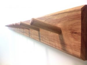 Coat hooks all wood rack of pegs